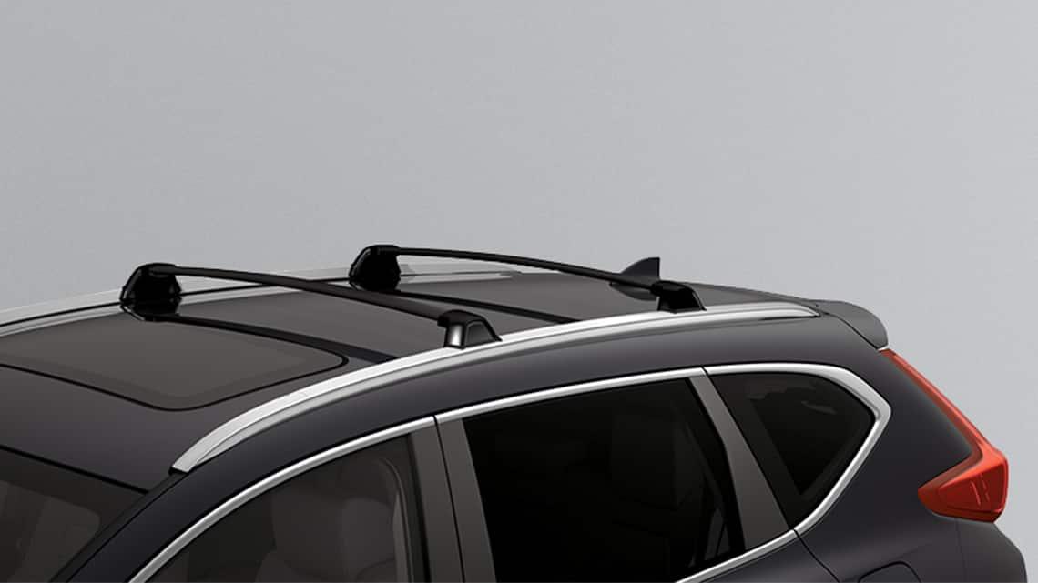 Se muestra la Honda CR-V 2019 con accesorio de portaequipajes y barras portaequipajes originales Honda.