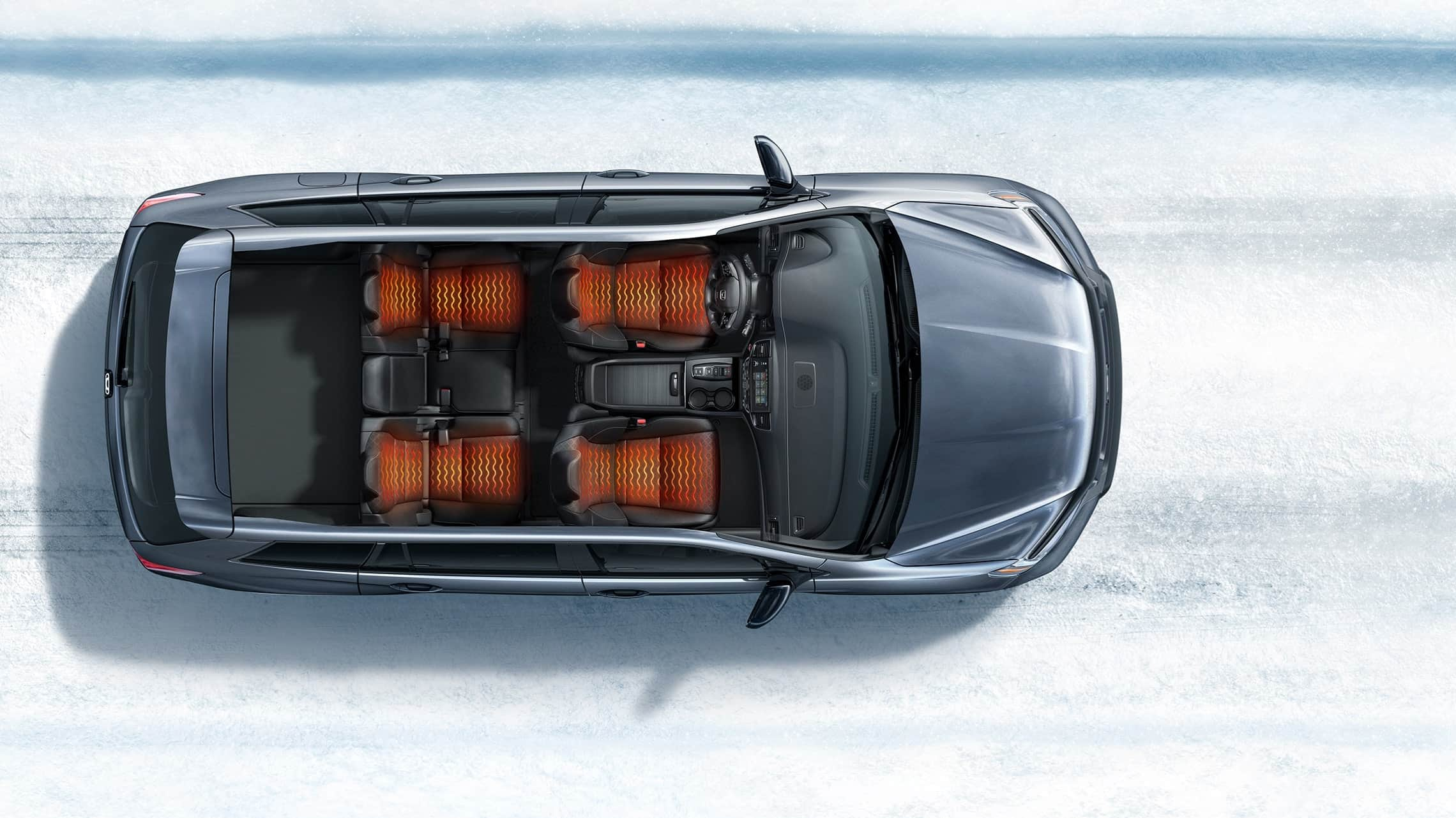 Overhead view of 2019 Honda Passport Elite demonstrating heated seats in a snowy road environment.
