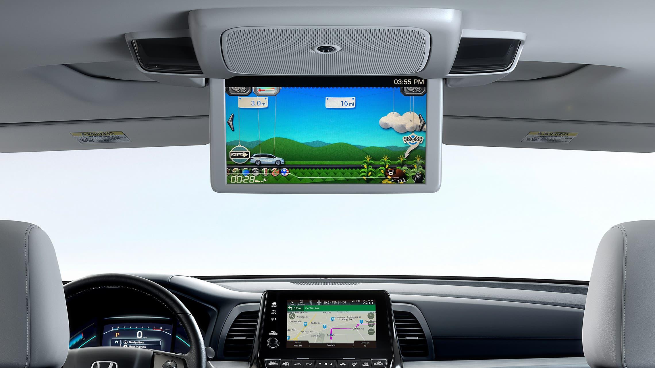 Detalle del sistema de entretenimiento trasero de avanzada en la Honda Odyssey Elite2020 con Gray Leather.